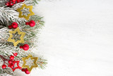 Fir branch with Christmas decorations on old wooden shabby background with copy space for text. - 183967615