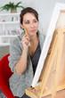 beautiful brunette woman painting on canva - 183969211