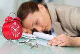 tired woman is sleeping on her desk in the office - 183969244
