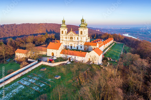 Keuken foto achterwand Krakau Camaldolese monastery and baroque church in the wood on the hill in Bielany, Krakow, Poland , Aerial view in sunset light with Vistula River and far view of Cracow city in the background