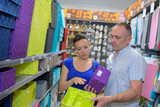 Couple looking at colorful storage boxes - 183970845