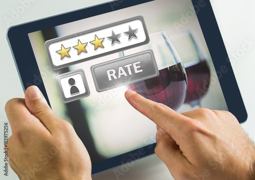 Poster Hand touching tablet with Rate button and review stars in wine