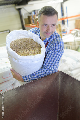 man with seeds in a factory
