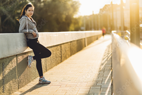 Poster Sportswoman resting after jogging