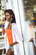 Beautiful black woman talking on phone and smiling