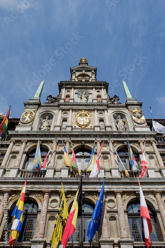 Foto op Canvas Antwerpen Flags on the town hall of Antwerp