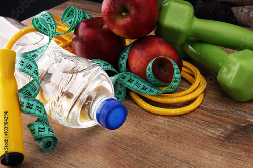 Poster Fitness concept dumbbells, skipping rope, bottle water, apples and tape measure