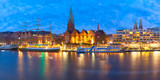 Embankment of the Weser River and Protestant Lutheran Saint Martin Church in the old town of Bremen, Germany. Night panoramic view. - 184001069