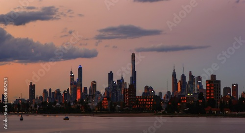 Poster Chicago Melbourne city skyline Australia at dusk with the orange glow of the sun reflecting from it's glass window's.