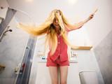 Woman brushing her long hair - 184007667
