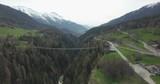 Large pedestrian bridge in Switzerland landscape, aerial - 184009010