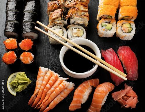 Foto op Plexiglas Sushi bar Sushi Set nigiri, sushi rolls and sashimi.