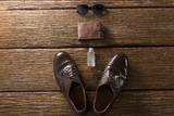 Shoes, perfume, wallet and sunglasses on wooden plank - 184027027