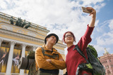 Young couple of tourists taking selfies against the Bolshoi theatre in Saint-Petersburg - 184029811