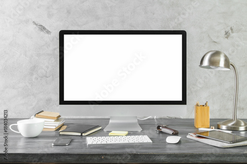 Desktop with empty white computer monitor front