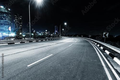 Fotobehang Kuala Lumpur nigh scene of empty road in modern city