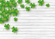 St Patricks day background design of clover leaves on white wood with copy space vector illustration