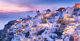 Magnificent twilight scenery of town Oia - IA skyline on Wonderful island Santorini in warm waters of Greek Aegean Sea, Mediterranean region. Wonderful lights of night village at the slope of volcano. - 184036018