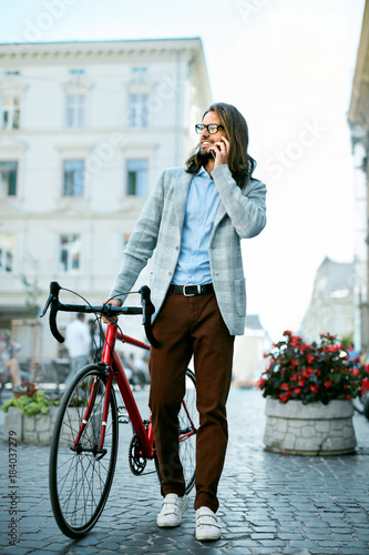 Man Bike Fashion. Male With Bicycle And Phone Going To Work.