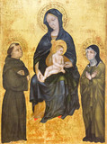 Pavia, Italy. November 11 2017. The painting of Virgin Mary with Baby Jesus with Saint Francis of Assisi and Saint Clare. Found in Castello Visconteo (Visconteo Castle) - 184039863