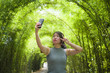 Quadro young pretty Chinese Asian woman enjoying having fun taking selfie picture with mobile phone camera posing cool