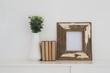 Quadro Wooden frame, vase and books arranged on table