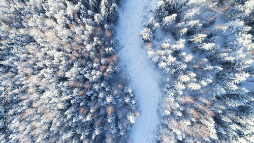 top view of snowy winter forest and road