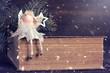 Christmas angel holding Christmas star