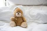 Bear is on bed - 184059082