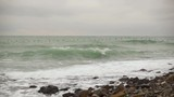 Super slow motion. Flock of birds ducks flying over a very beautiful stormy sea low - 184065635