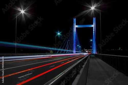 Foto op Aluminium Nacht snelweg Beautiful colorfull bridge in the evening