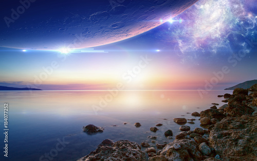 Fototapeta Wallpaper for ambient and chillout music, glowing sunset, serene sea, planet and spiral galaxy