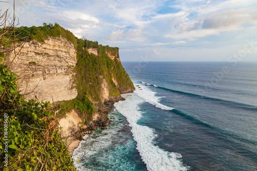 Tuinposter Beige Beautiful view of ocean rocky cliff near Uluwatu temple. Scenic landscape of fantastic view. Bali, Indonesia.