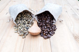 Bag of coffee beans and a cup of coffee on the table - 184086637