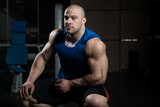 Muscular Man After Exercise Resting In Gym - 184096409