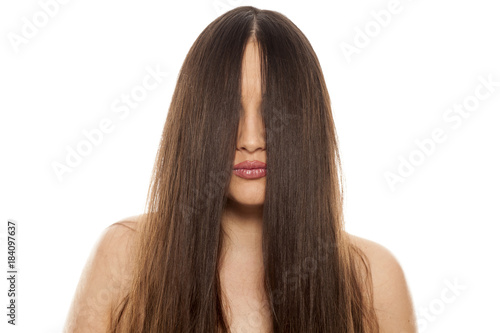Plexiglas Kapsalon young beautiful woman with a hair over her face