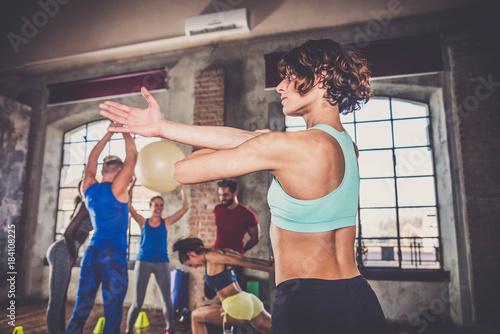 Plexiglas Fitness Athletes training in a gym