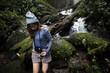 Asian woman enjoying an outdoor trip - 184111031