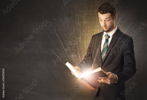 Man holding a book.