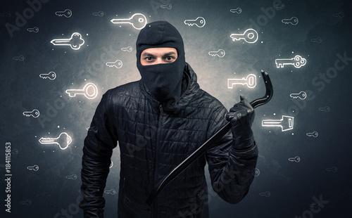 Staande foto Hoogte schaal Burglar holding tool.