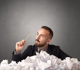 Businessman behind crumpled paper - 184116060