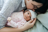 a mother's daytime sleep with her newborn baby. tired but happy. family values. - 184122206