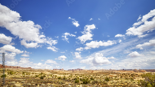 Wall mural Vast deserted landscape with beautiful cloudscape on the blue sky.