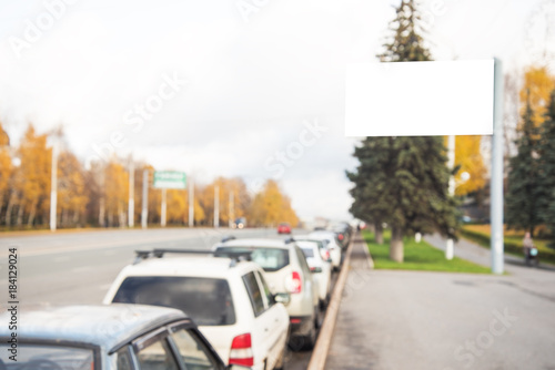 Blank billboard under road with cars - 184129024