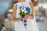 Beautiful woman in white dress with wedding bouquet - 184129439