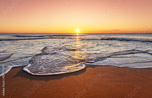 Tuinposter Diepbruine Amazingly colorful sea beach sunset. Golden sands!