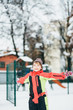 Little girl child playing on the palyground in winter