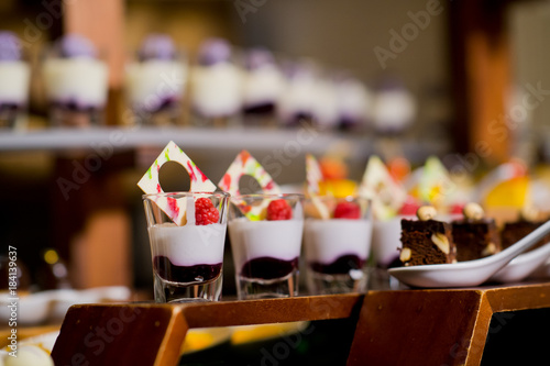 Glass shots  pastry. wedding catering food. mini canapes food.  tasty dessert. Beautiful decorate catering banquet table.  snacks and appetizers. wedding celebration - 184139637