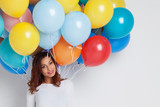 Happy woman with balloons - 184143455