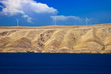 Stone desert island of Pag wind power plants view - 184150495